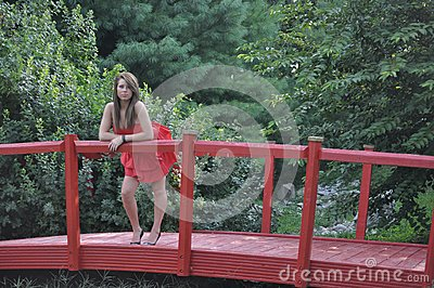She Stands Upon the Red Bridge