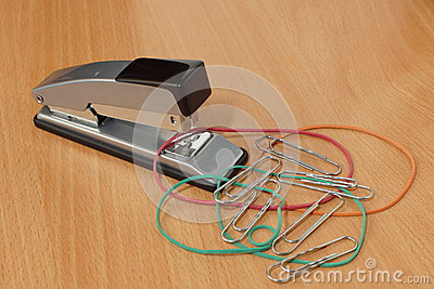 Stapler, elastic bands and clips.