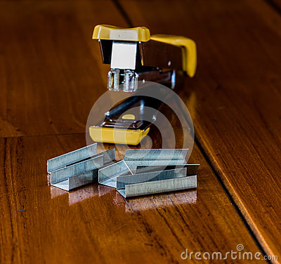 Free Stapler Is On The Wood. Royalty Free Stock Photo - 67211925