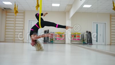 star inversion aerial antigravity yoga pose woman