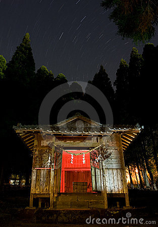 Star trails above a rural Japanese shrine