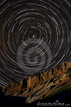 Free Star Trails Around Polaris Above A Sandstone Cliff Royalty Free Stock Images - 13062179