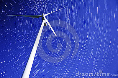 Star trails over a wind power generator