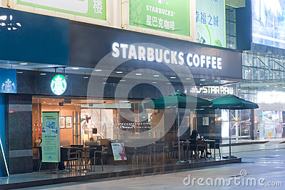 Starbucks Coffee at night Editorial Stock Photo