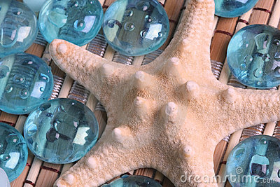 Starfish and glass pebbles