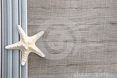 Starfish on grey wooden background