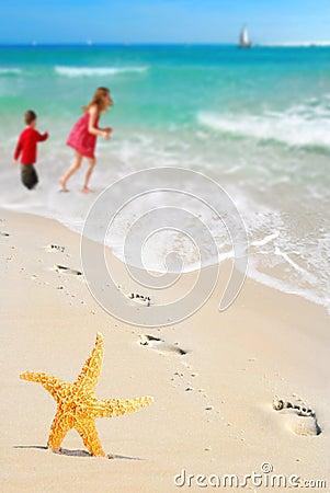Starfish, kids and Footprints on Beach