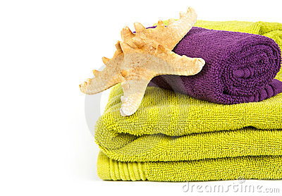 Starfish on stack of colorful towels
