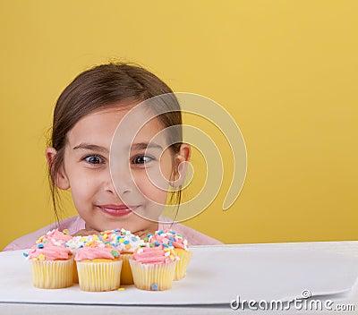 Staring cross eyed at a cupcake