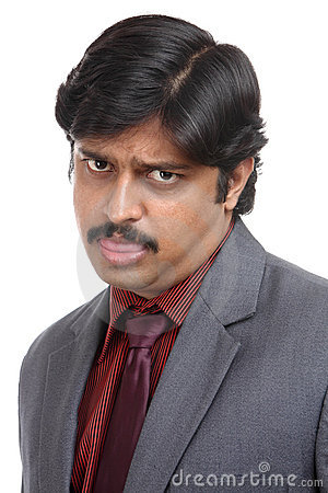 Starring with angry Indian business man portrait