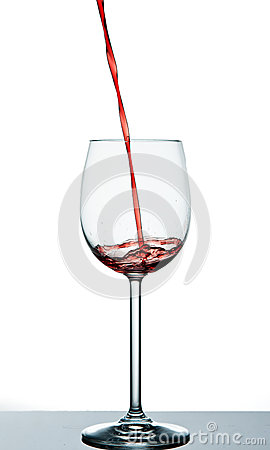 Start to pour red wine into wine glass