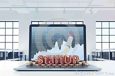 Start up, laptop with graph, office Stock Photo