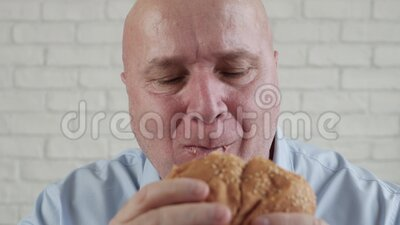 Starved Person Eating a Tasty Hamburger, Enjoy a Delicious Snack in a Fast Food Restaurant.  stock video