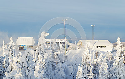 Station of the ski lift on snow-covered top of mountain