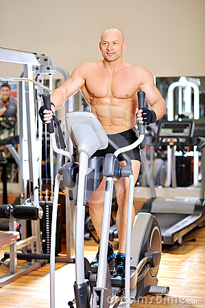Stationary bicycles. Fitness man