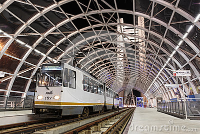 Stationary tram in modern station Editorial Image