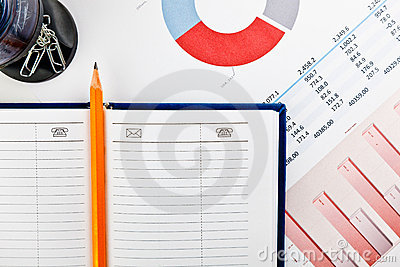 Stationery and financial documents with charts