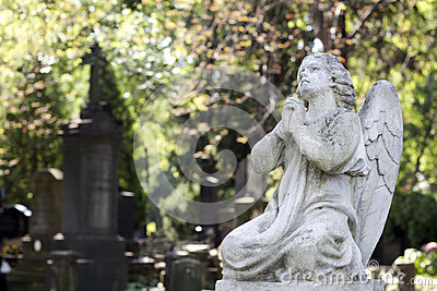 Statue Of Ancient Angel On Cemetery Stock Photos - Image: 26458313