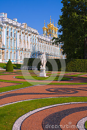 Statue and the Catherine Palace in a sunny weather.