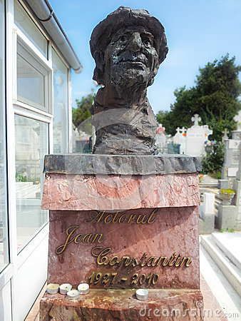 Statue of comedian Jean Constantin in cemetery Editorial Stock Image
