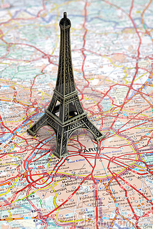 Statue of Eiffel Tower on map of Paris