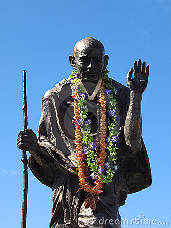 Statue of Ghandi wearing real leis Editorial Stock Image