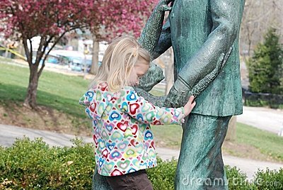 A statue and a girl
