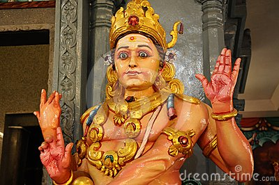 The statue of a god in Kali Mandir temple in India
