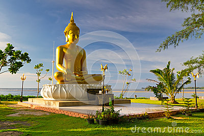 Statue of golden Buddha at the sea in Thailand