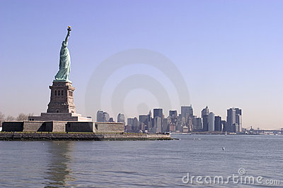 The Statue of Liberty and lower Manhattan skyline - New York