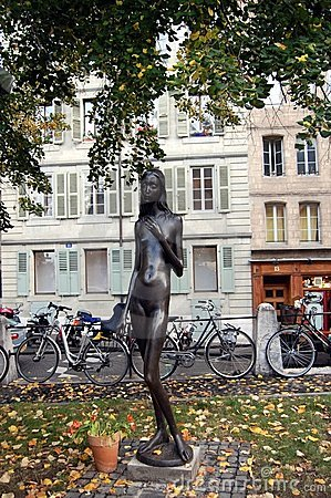 A statue of a naked slim girl in the park, Geneva