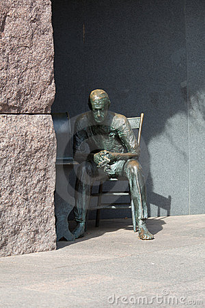 Statue of poor man listening to radio