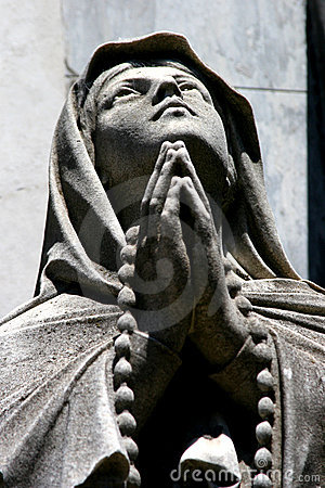 Statue of a praying person