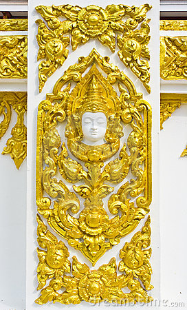 Statue about religion on the wall, Thai temple