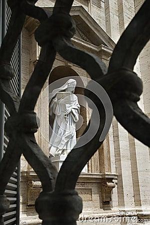 Statue of Saint Teresa of Avila Viewed Through Fen