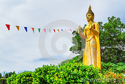 Statue of standing golden Buddha