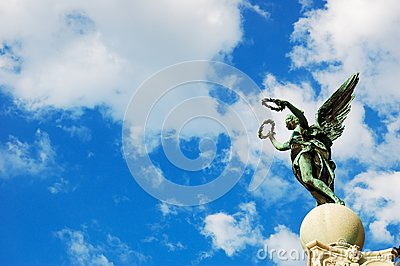 Statue on the top of a pillar