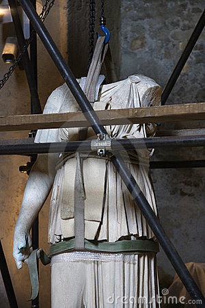 Statue under restoration, Rome, Italy.