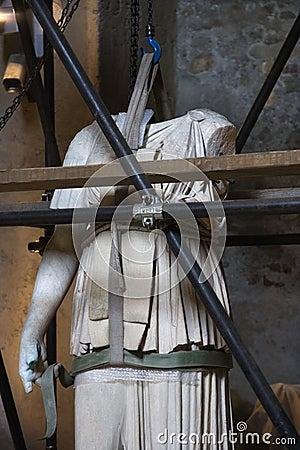 Statue under restoration, Rome, Italy.