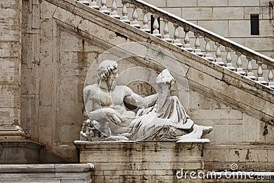 Statues in Campidoglio square under snow