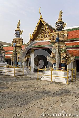 Statues guarding temple door
