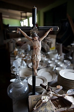 Statuettes of Jesus on crucifix in thrift store