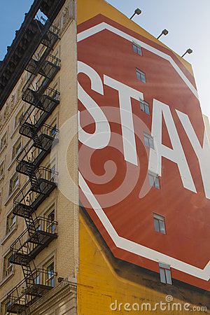 Stay sign painted on building