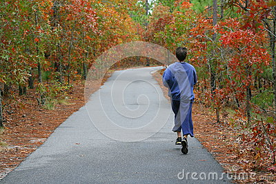 fall colors and male jogger in sweat pants. Editorial Photography