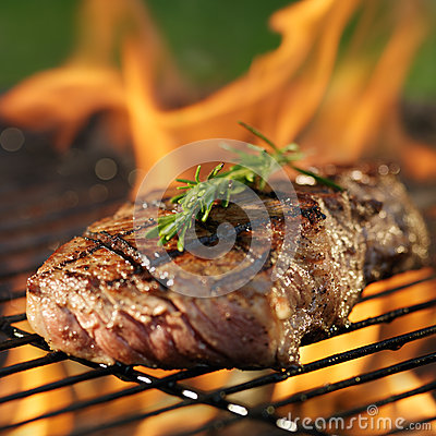 Free Steak Cooking Over Flaming Grill Royalty Free Stock Photo - 50315445