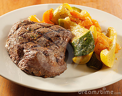 Steak with grill marks and vegetables,