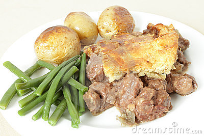 Steak and kidney pie on plate
