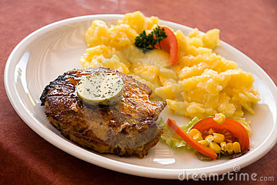 Steak of pork,grilled-with salad of potatoes