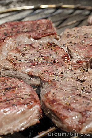 Steaks on barbecue grill