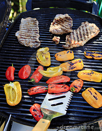 Steaks and peppers on the barbecue